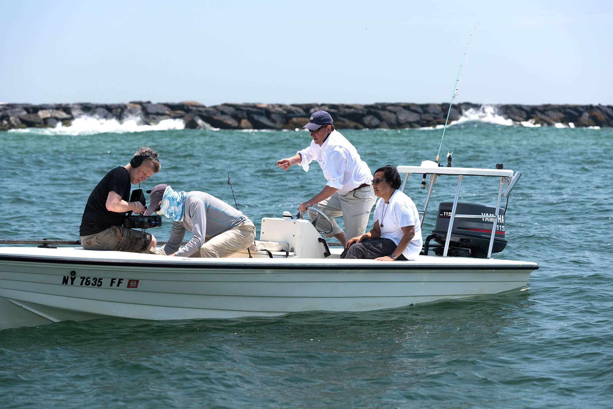 Measuring a striper in Moriches inlet