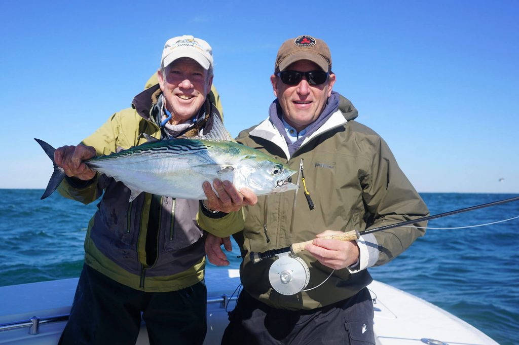 Captain Paul Dixon and Colin Ambrose in Montauk with Albie and a Rise rod tibor reel