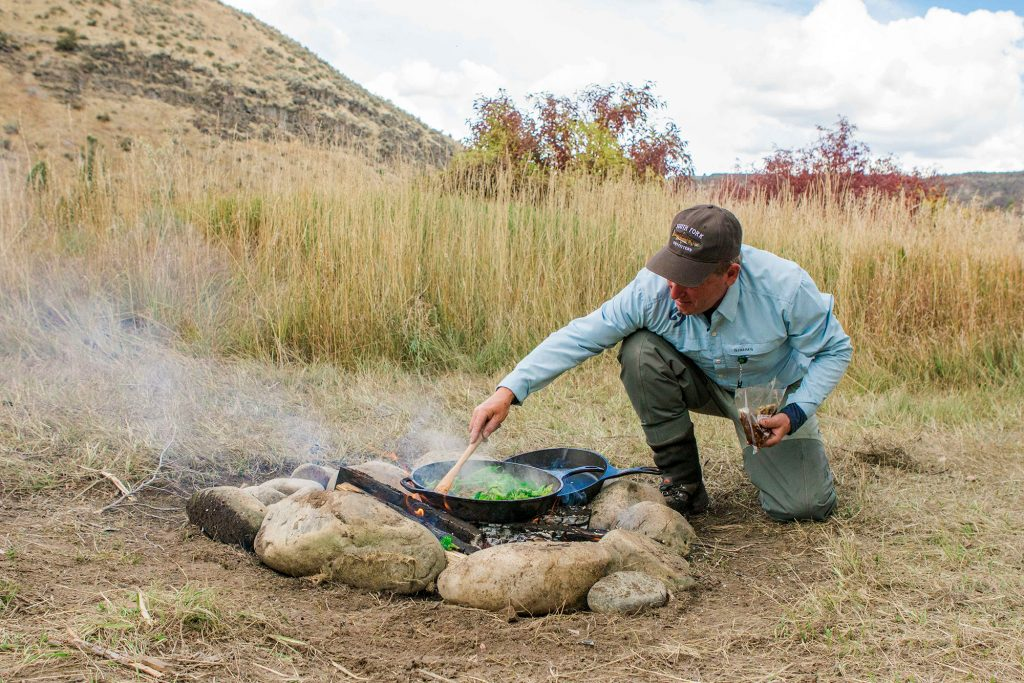Cooking elk over fire, Snake river, 10.19.17