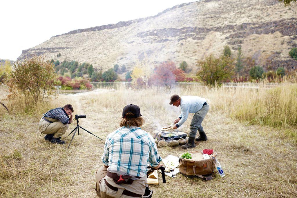 Cooking Idaho Surf & Turf over open fireon camera
