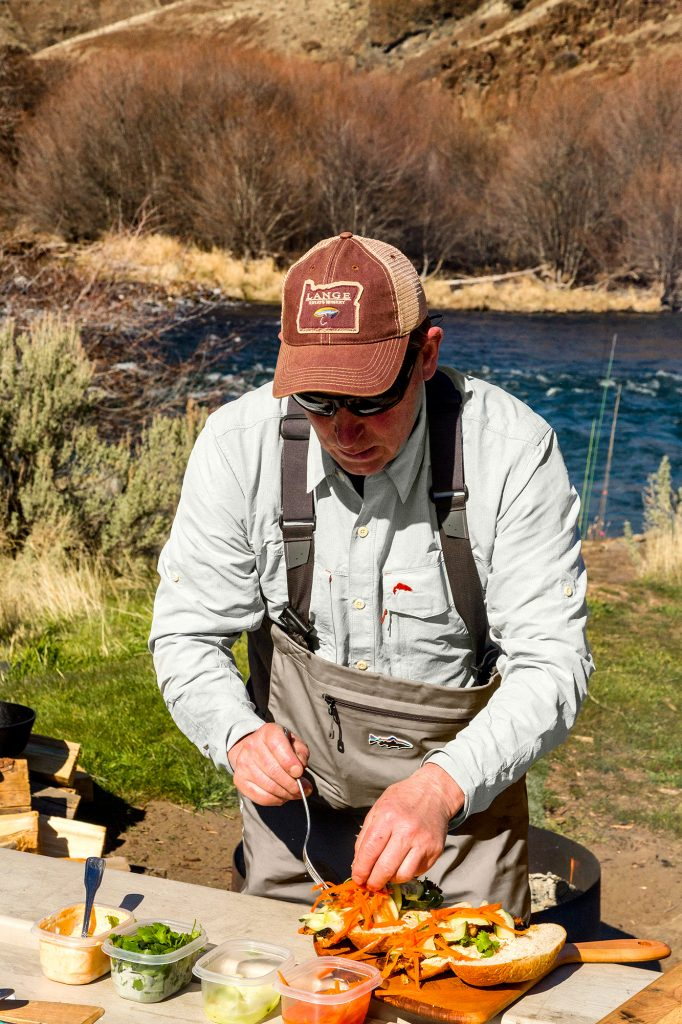 Fly fishing, cooking over fire, floating and enjoying a glass of wine on the Deschutes River in Oregon