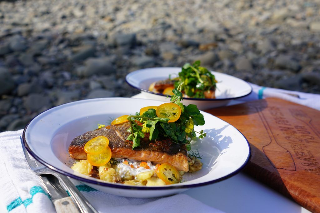 Steelhead lunch dish prepared over open fire by the eel river