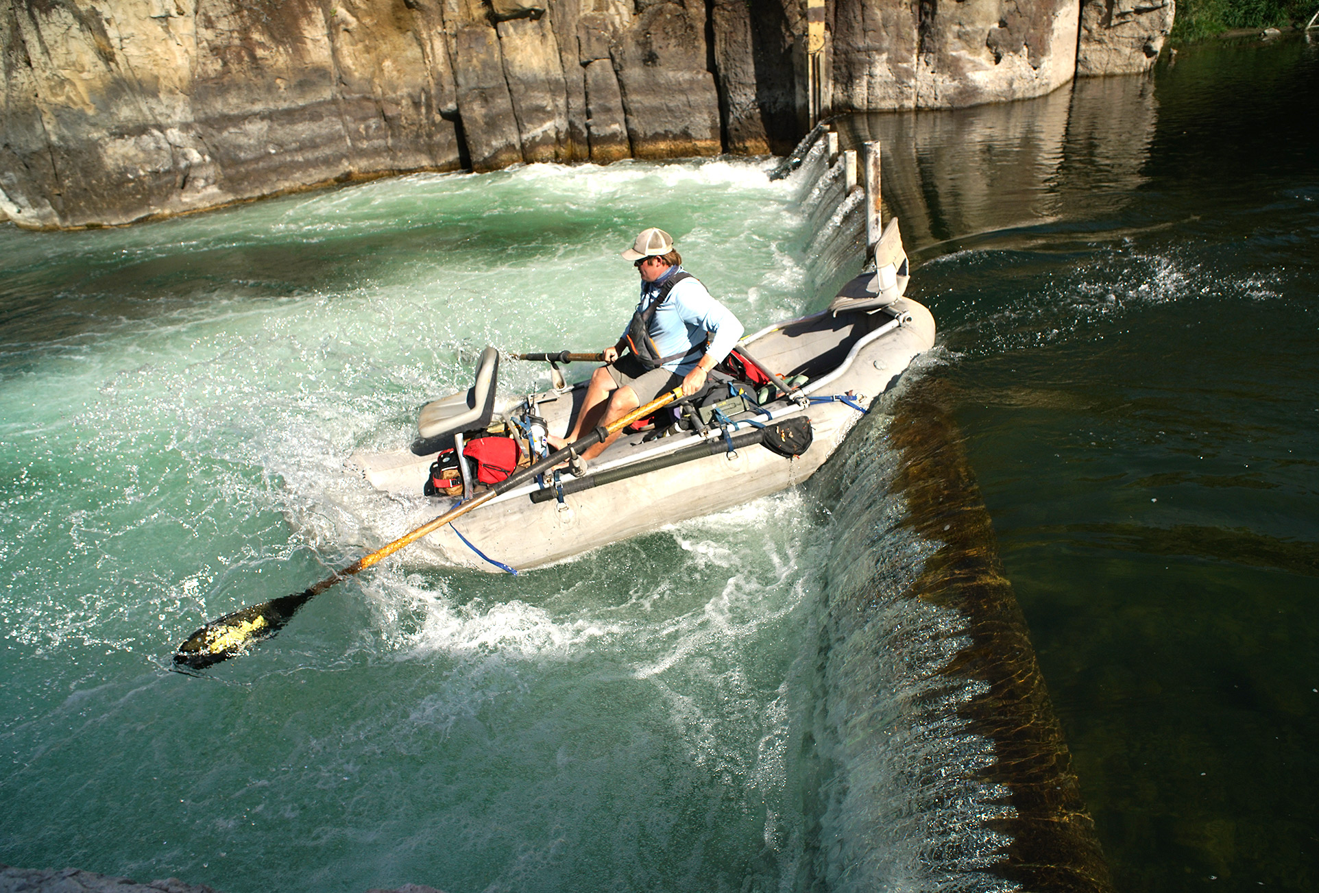 Worldcast Anglers guide Joe Harris dropping in over a spillway on the Teton river, Idaho