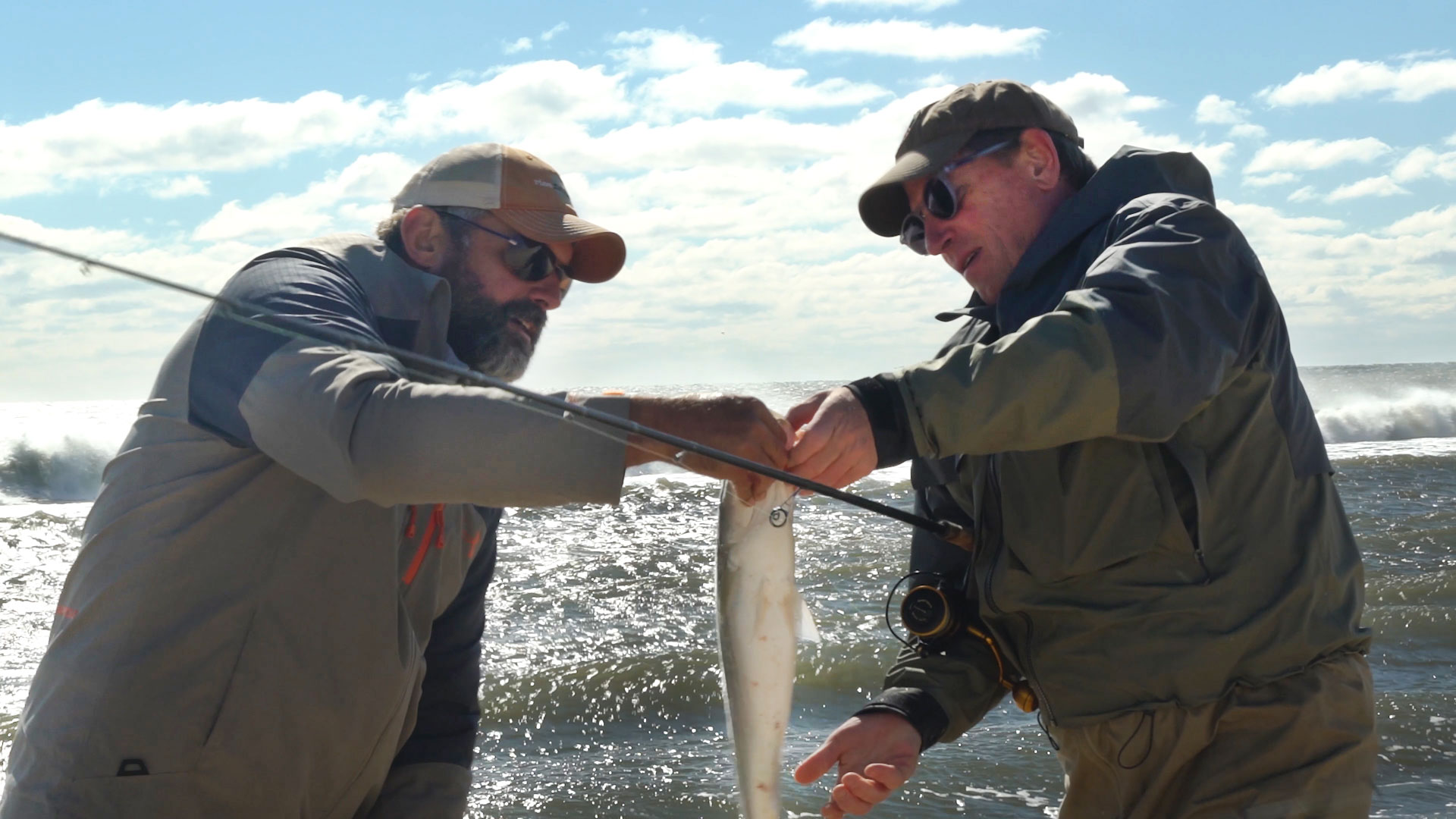 Passing off fish at Sagg Main Beach
